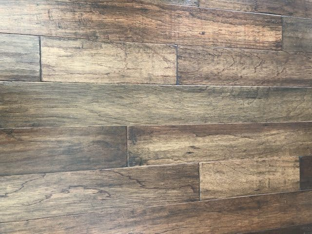 The differences between solid hardwood and engineered wood flooring. Comparing cost, durability, installation methods of both types of wood flooring.
