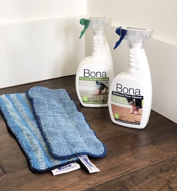 The three products that I use to keep my engineered wood floors clean. Safe and effective for your solid hardwood floors too!