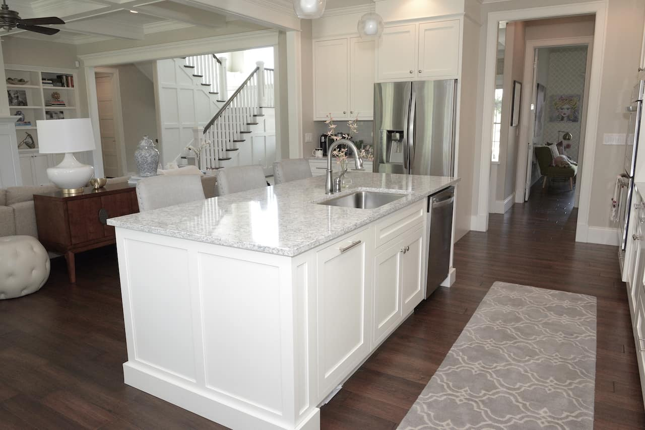 how to fill space between cabinets and ceiling in kitchen and family room