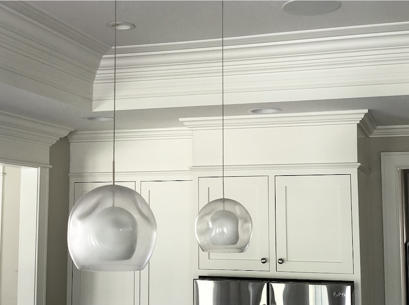 how to fill space between cabinets and ceiling in white kitchen with cabinet soffit