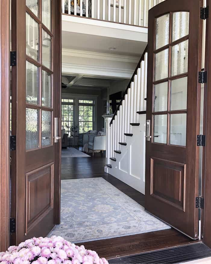 Arched real wood double doors open to foyer