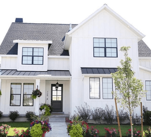 White home exterior with black roof and black windows.