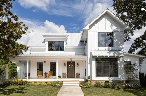 White home exterior with board and batten and black windows.