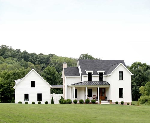 White modern farmhouse with covered porch.