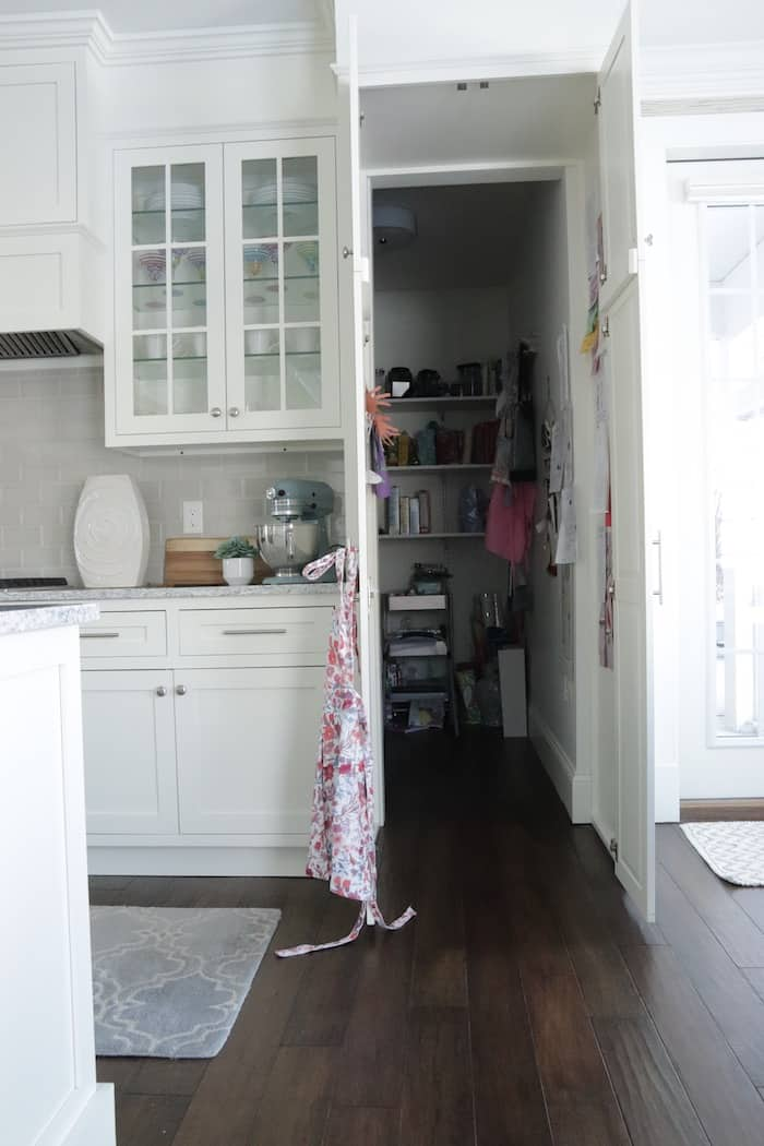 Tips for designing a functional kitchen hidden pantry open