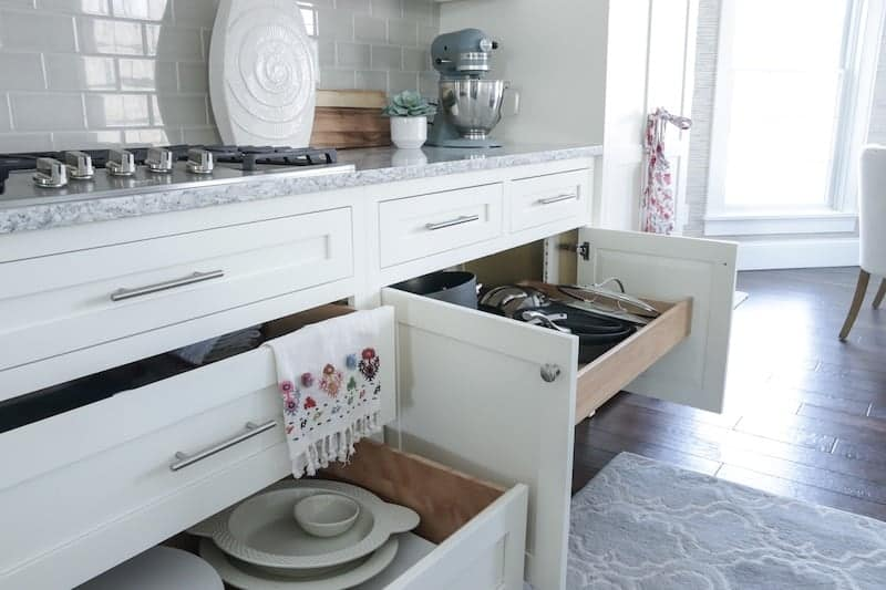 Tips for designing a functional kitchen open drawers
