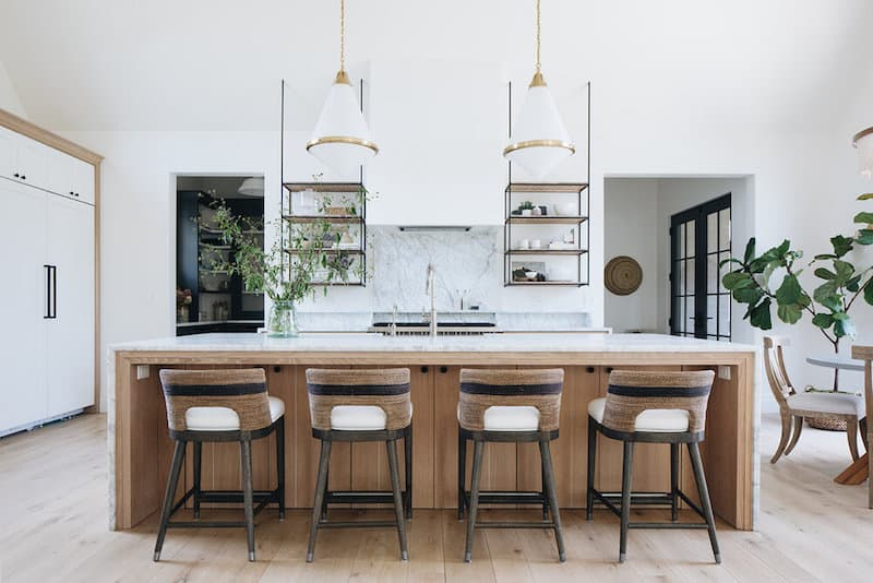 White and wood kitchen with open shelving.
