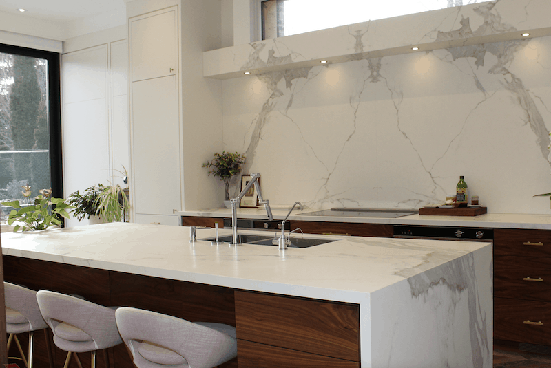 kitchen with porcelain countertops that have grey veining and resemble marble