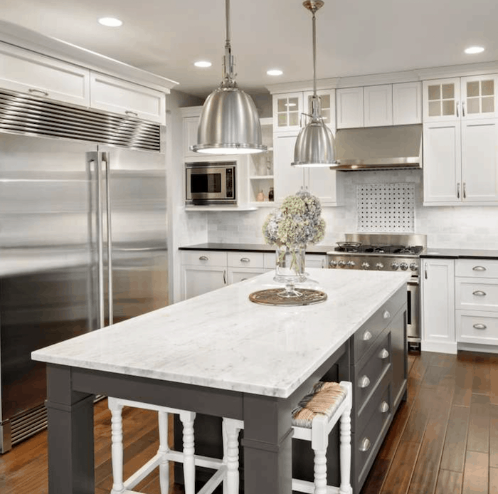 grey and white kitchen with porcelain countertops and shaker style cabinet doors